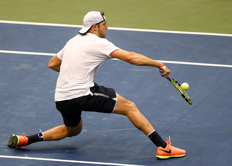 United States' Jack Sock slides to return a hit from Switzerland's Marco Chiudinelli during a Davis Cup tennis match, on Friday, February 3, 2017, in Birmingham, Alabama. Photo: AP