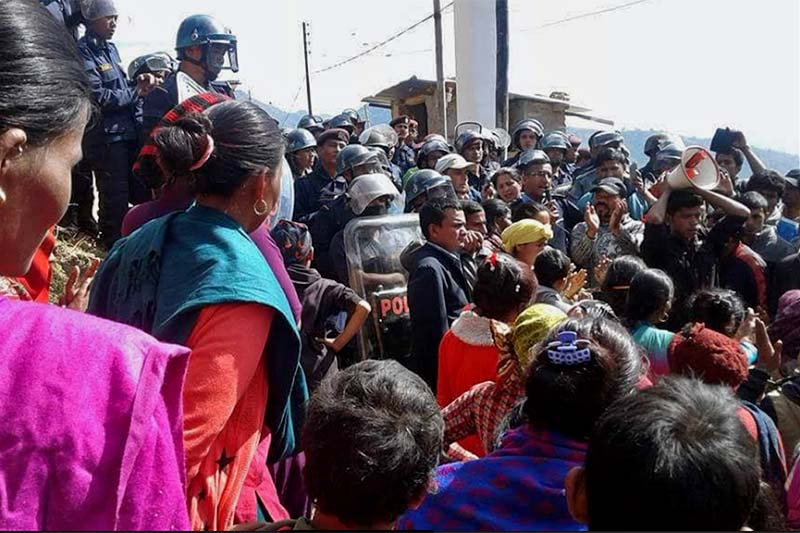Locals of Jajarkot district headquarters, Khalanga, stage a protest in front of the District Police Office, seeking action against a policeman allegedly involved in the murder of a local woman, on Wednesday, February 8, 2017. Photo: Dinesh Kumar Shrestha