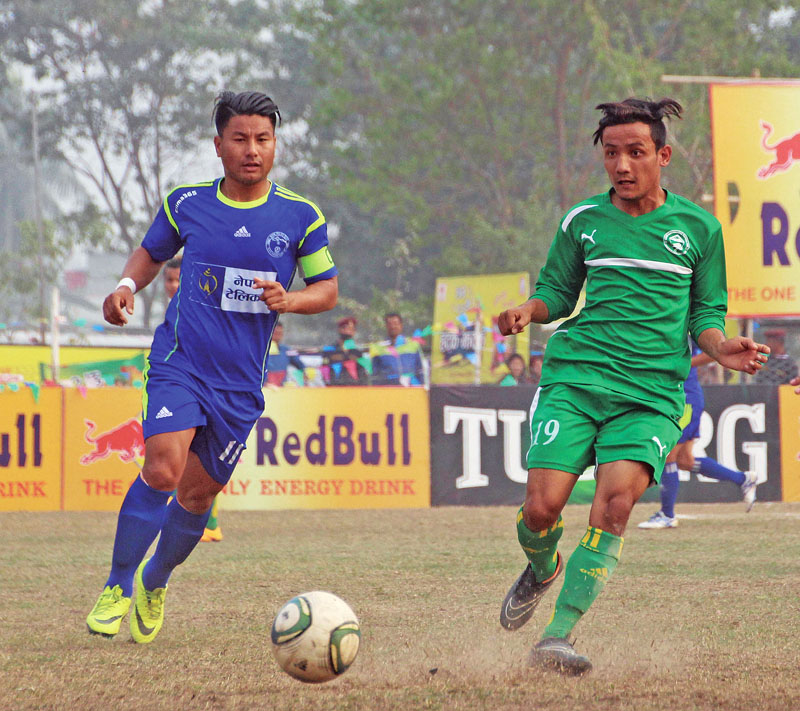 NPC's Jumanu Rai (left) vies for the ball with a Kanchanjunga player during their 19th International Invitational Red Bull Budha Subba Gold Cup match in Dharan on Tuesday, February 21, 2017. Photo: THT