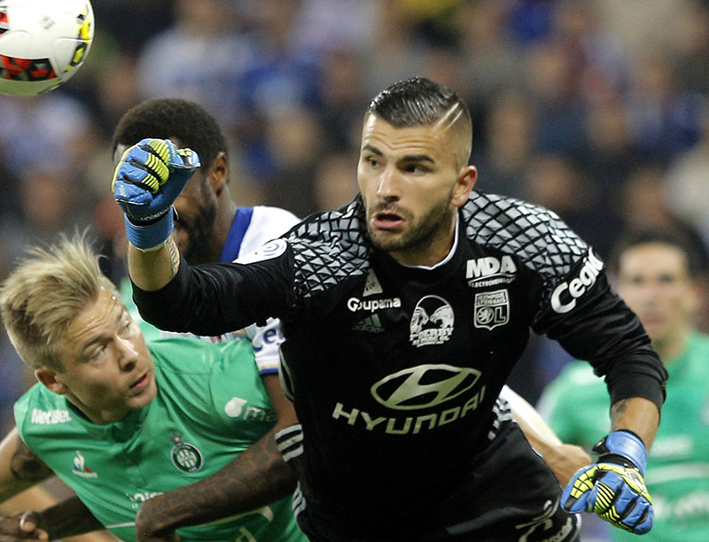 FILE - Lyon's goalkeeper Anthony Lopes (right) bats the ball away during the French League One soccer match between Lyon and Saint-Etienne, in Decines, near Lyon, central France, on Sunday, October 2, 2016. Photo: AP