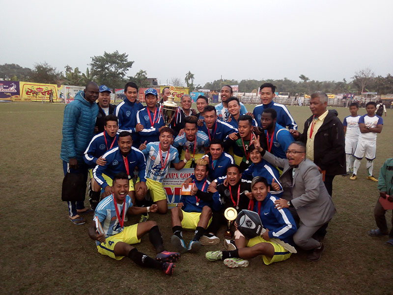 Manang Marshyangdi Club players and officials celebrate after winning the second Rumpum Jhapa Gold cup at the Domalal Stadium in Birtamod, Jhapa on Monday, February 6, 2017. Photo: THT