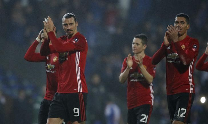 Britain Football Soccer - Blackburn Rovers v Manchester United - FA Cup Fifth Round - Ewood Park - 19/2/17 Manchester United's Zlatan Ibrahimovic, Ander Herrera and Chris Smalling applaud fans after the game  Reuters / Phil Noble Livepic