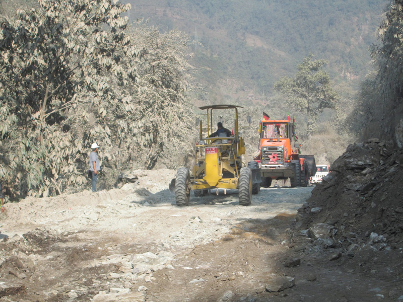 Bulldozers and loaders are used to widen the Muglin-Narayangadh raod section in Chitwan district, on Tuesday, February 7, 2017. Photo: Madan Wagle