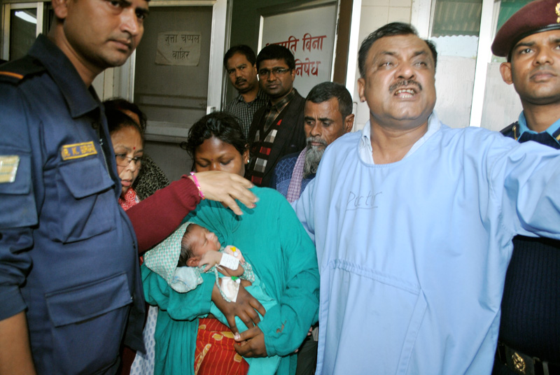 Police hand over a newborn baby, who was missing but found safe today, to his mother at the Narayani Sub-Regional Hospital in Birgunj on Sunday, February 5, 2017. Photo: Ram Sarraf
