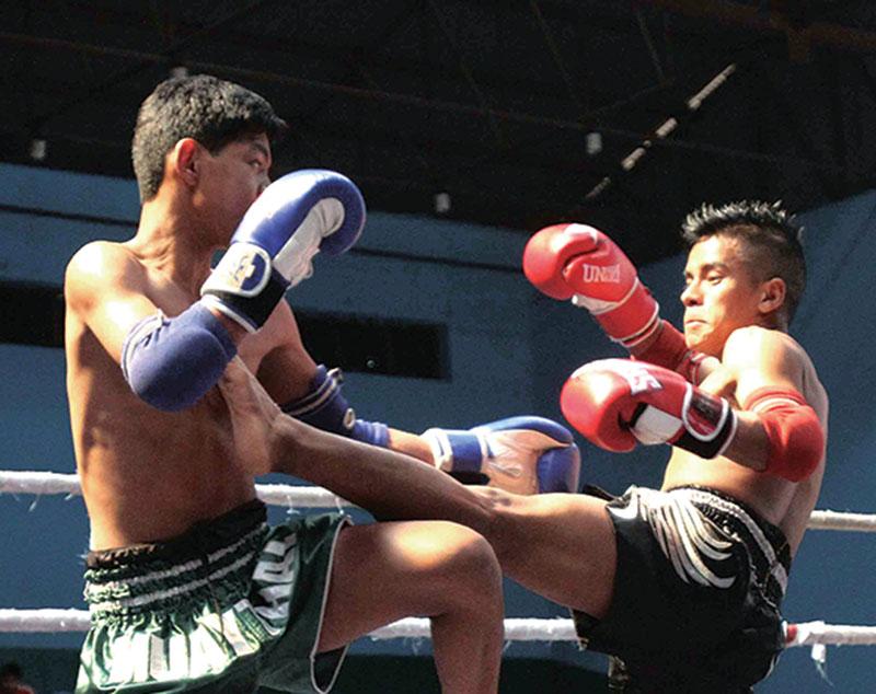 Sushil Shah Thakuri (left) of Central Muay Thai fights against Rahul Thokar Lama of Nepal rNational Muay Thai during their menu2019s below-50kg bout of the National Muay Thai rChampionship in Kathmandu on Saturday, February 25, 2017. Photo: Udipt Singh Chhetry/ THT