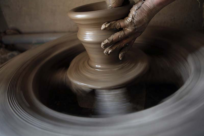 A Nepali potter moulds a clay pot in a potters wheel in the ancient Nepali town of Thimi on Wednesday, January 25, 2017. Photo: AP