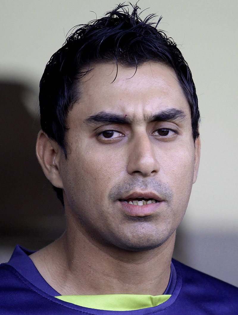 FILE - Pakistan cricketer Nasir Jamshed speaks during a press conference in Lahore, Pakistan, on Monday, February 9, 2015. Left-handed opening batsman Nasir Jamshed became the third player to be provisionally suspended by the Pakistan Cricket Board on Monday in its on-going investigation into corruption in Pakistan Super League. Photo: AP