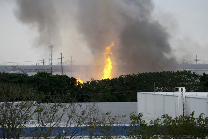 Flames rise from a huge fire at the House Technology Industries (HTI) factory inside the Export Processing Zone Authority for more than twenty hours, Thursday, Feb. 2, 2017 in General Trias township, Cavite province south of Manila, Philippines. Photo: AP
