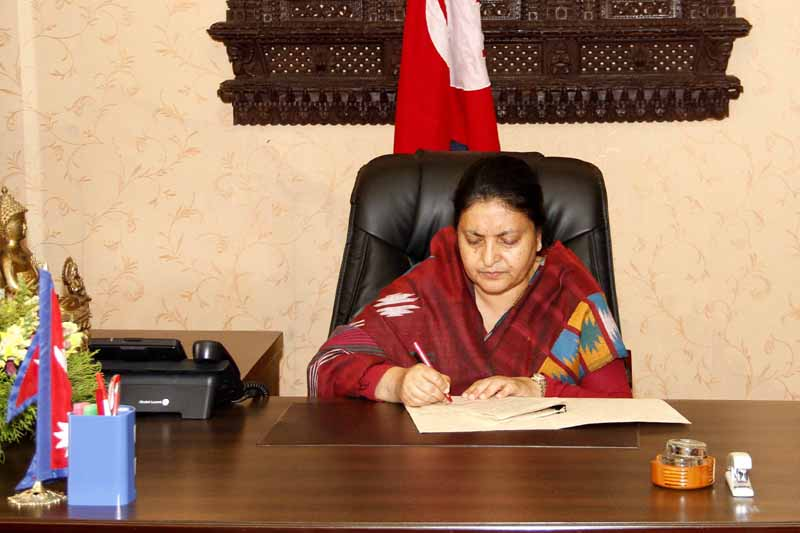 President Bidya Devi Bhandari authenticates the Local Level Election Bill and the Election Offence and Punishment Bill on Friday, February 10, 2017. Photo: President's Office