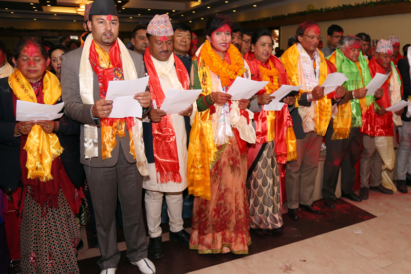 Newly elected Central Committee members of Rastriya Prajatantra Party take the oath of office and secrecy from Chairman Kamal Thapa after party's unity convention, in Kathmandu, on Wednesday, February 22, 2017. Photo: RSS