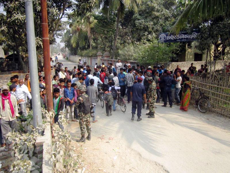 Locals gather as a socket bomb was found at the gate of Peace Zone English Boarding School in Rajbiraj-9 of Saptari district on Tuesday, February 28, 2017. Photo: Byas Shankar Upadhyaya