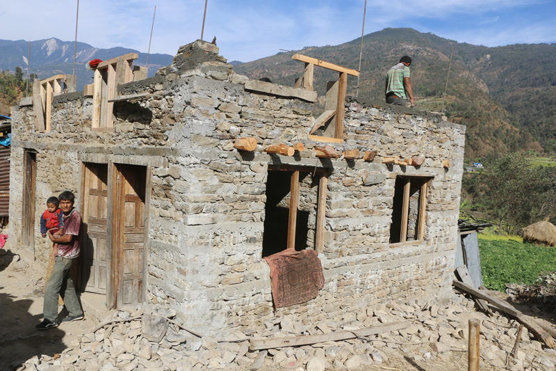 Quake survivors who failed to receive reconstruction grant from the government continue to build their house in Mahankal-9 of Kavrepalanchok district, on Friday, February 10, 2017. Photo: RSS