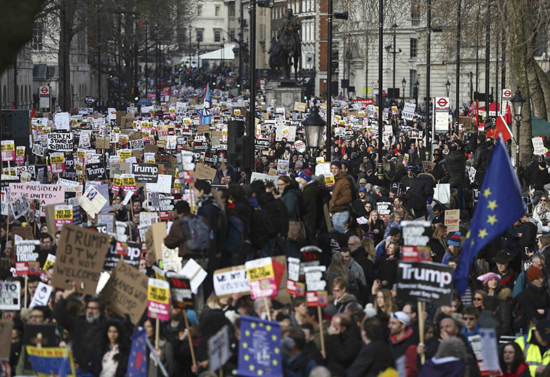 Demonstrators hold placards outside Downing Street during a march against US President Donald Trump and his temporary ban on refugees and nationals from seven Muslim-majority countries from entering the United States, in London, Britain, on February 4, 2017. Photo: Reuters