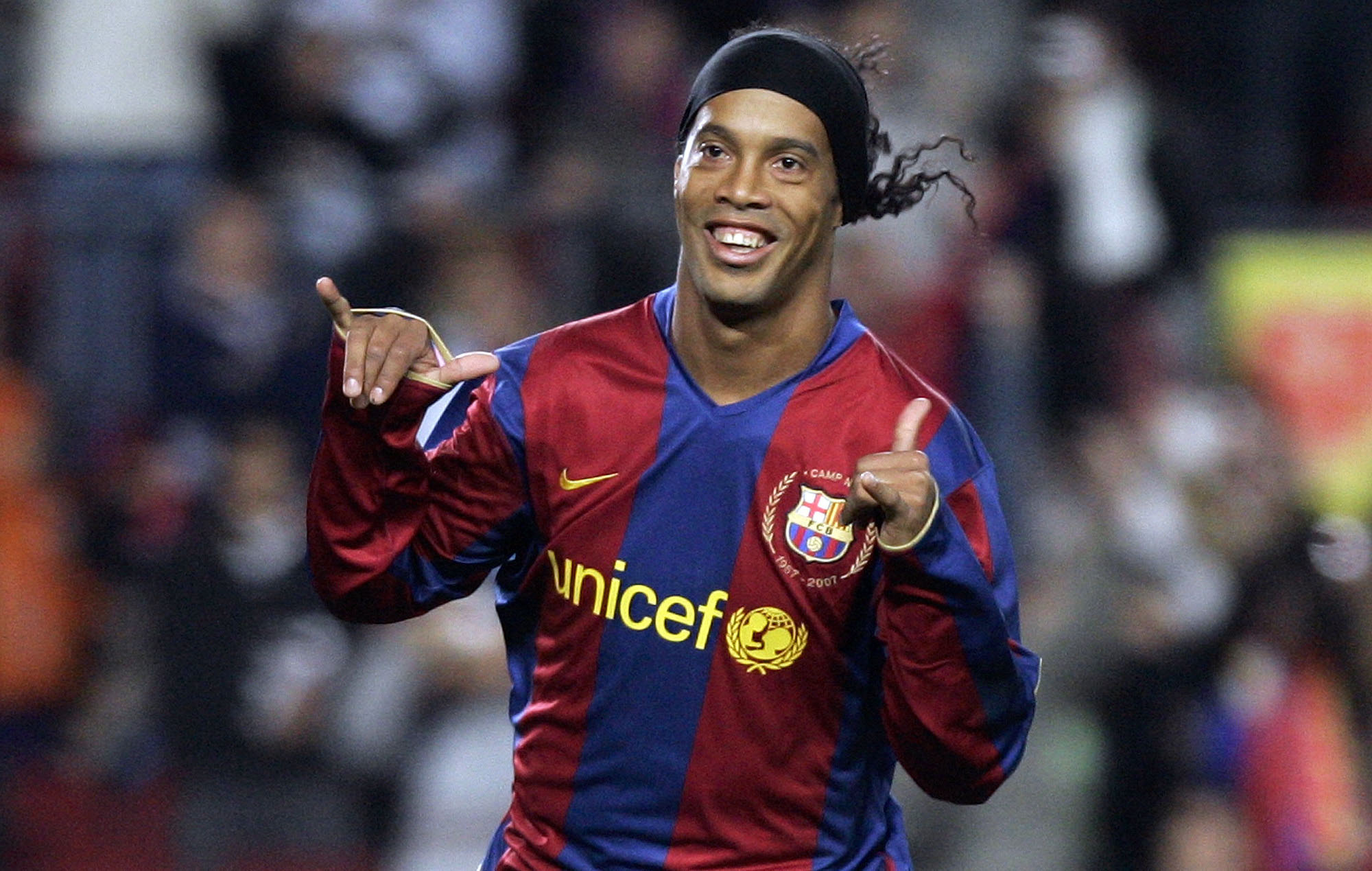 FILE - FC Barcelona player Ronaldinho, from Brazil, celebrates his goal against Deportivo Coruna during his Spanish league soccer match at the Camp Nou Stadium in Barcelona, Spain, on December 9, 2007. Photo: AP