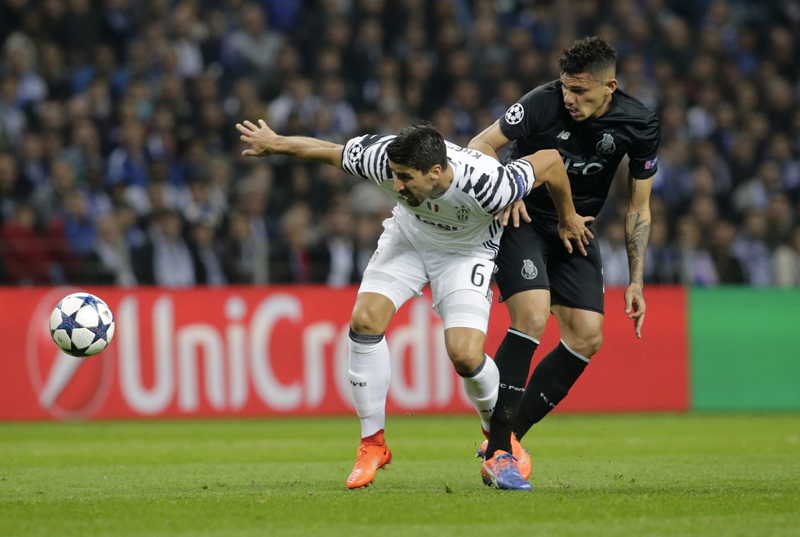 Juventus' Sami Khedira in action with FC Porto's Tiquinho Soares. Photo: Reuters
