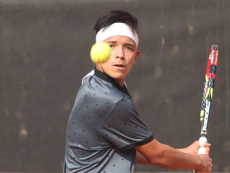 Samrakshyak Bhushan Bajracharya returns to Kumar Adhikari during their ninth Sahabir Memorial Open Tennis Tournament match in Kathmandu on Tuesday, January 31, 2017. Photo: Udipt Singh Chhetry/THT