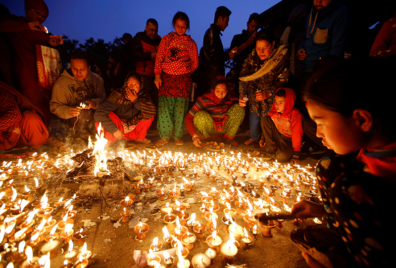 Devotees offer butter lamp to celebrate Shree Panchami festival at Saraswati temple in Kathmandu, on Wednesday, February 1, 2017. Photo: Reuters