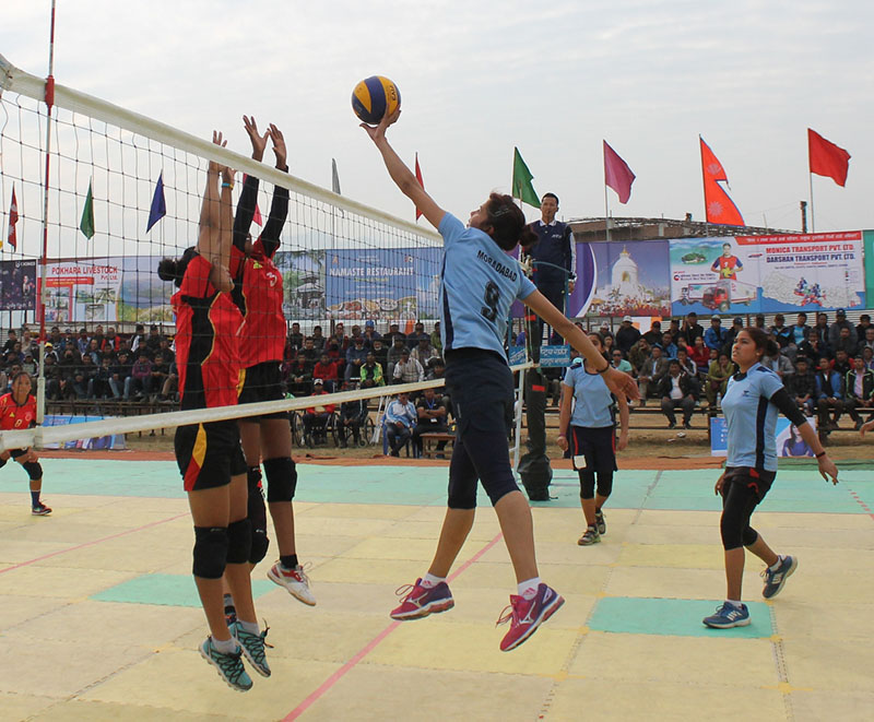 Ashu Rani (right) of Uttar Pradesh Volleyball Association looks for a placing as NPC spikers try to block the ball during their Shreejana International Volleyball Tournament match at the Pokhara Stadium in Pokhara on Sunday, February 5, 2017. Photo: THT