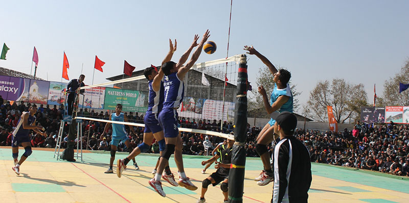 Players of TAC and  NPC (right) in action during their Shreejana International Volleyball nTournament final at the Pokhara Stadium on Saturday, February 11, 2017. Photo: THT