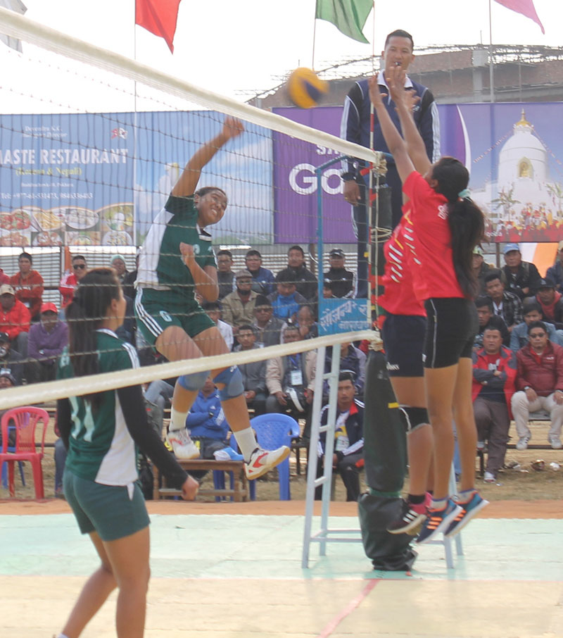 Players of  NDA (left) and Western Regional Volleyball Association in action during their Shreejana International Women and Men Volleyball Tournament match in Pokhara on Thursday, February 9, 2017. Photo: THT