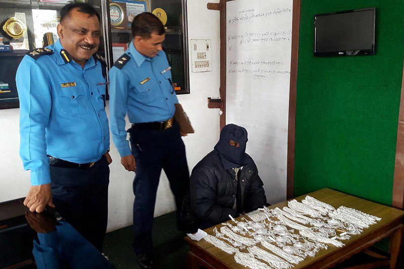 Police make public the alleged silver smuggler along with the seized ornaments at the Parsa District Police Office, Birgunj, on Wednesday, February 15, 2017. Photo: Ram Sarraf