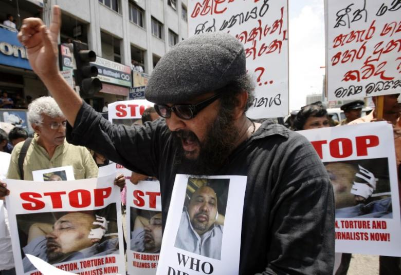 Sri Lankan journalists hold posters of Keith Noyahr, an editor and defence columnist, as they shout slogans against the government during a protest in Colombo May 23, 2008. REUTERS/Anuruddha Lokuhapuarachchi/File Photo