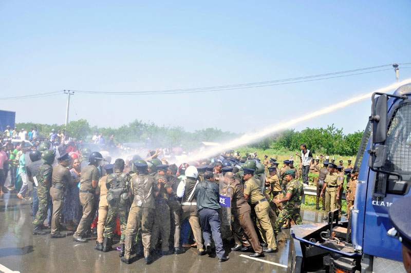 Police clash with demonstrators during a protest against the launching of a Chinese industrial zone by China Merchants Port Holdings Company, in Mirijjawila, Sri Lanka, on January 7, 2017.