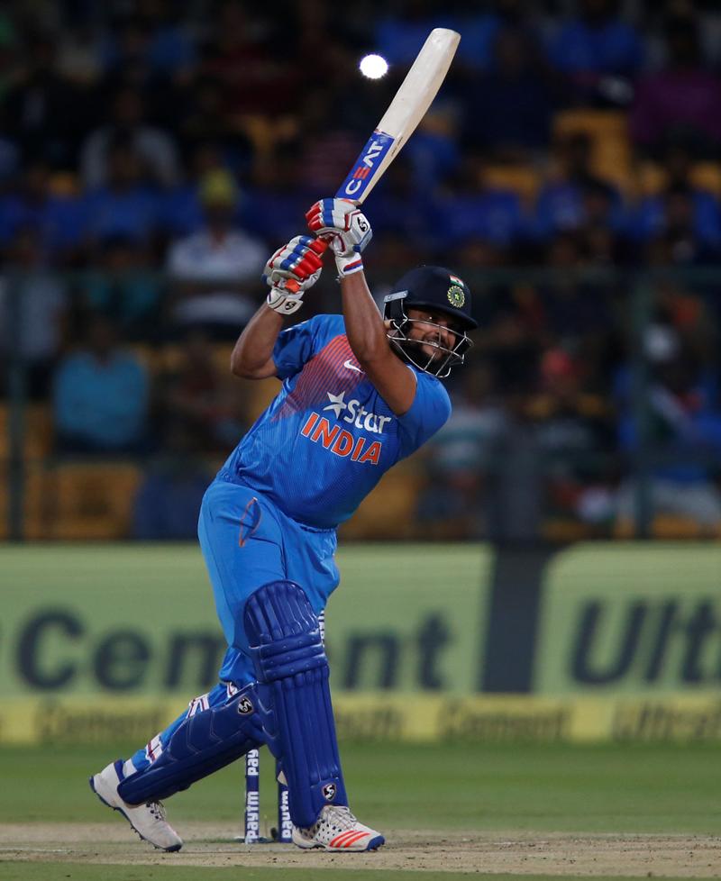 India's Suresh Raina plays a shot. Photo: Reuters