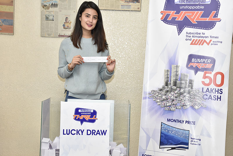 Model Niti Shah picks the receipt of the seventh lucky weekly winner of The Himalayan Times Unstoppable Thrill subscription campaign, at APCA House, Anamnagar, Kathmandu, on Monday, February 20, 2017. Photo: Naresh Krishna Shrestha/THT