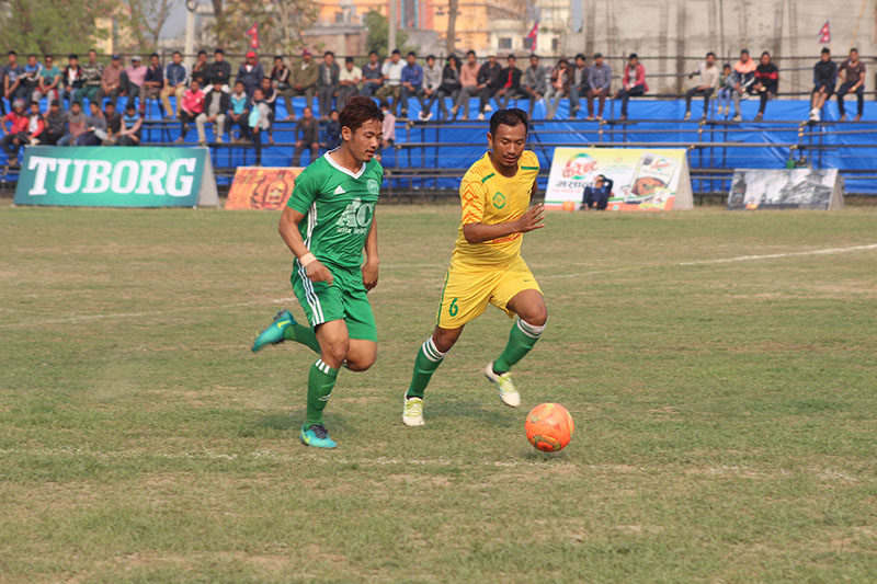 Players of Rupandehi (left) and Dharan vie for ball during their 19th Tilottama Gold Cup match in Butwal on Sunday, February 26, 2017. Photo: THT