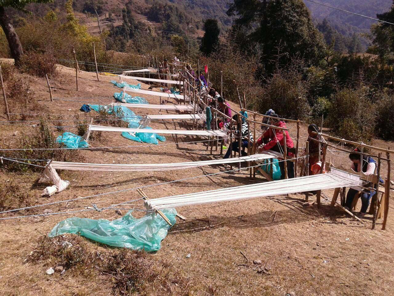 Trainers attend a training of weaving traditional khadi cloth in Khidim of Khotang district, on Sunday, February 12, 2017. Photo: RSS