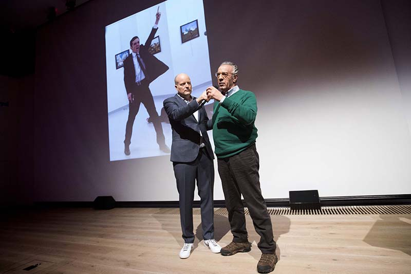 Winner of the World Press Photo 2016 photographer Burhan Ozbilici (right) and Managing Director of the World Press Photo Foundation Lars Boering, speak on stage during the announcement of the World Press Photo prizes in Amsterdam, on February 13, 2017. Photo: AFP