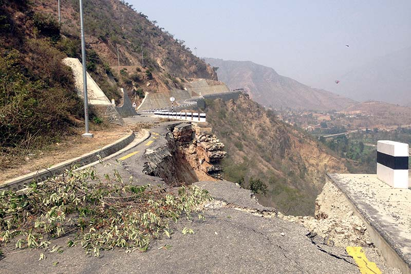 A road section along the BP Highway is seen after it caved in, on Monday, February 20, 2017. Photo: Min Kumar Dahal/THT