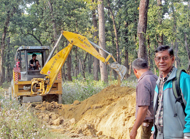 An excavator being used to demarcate borders of a community forest in Dhangadhi Sub-Metropolitan City in Kailali district, on Monday, February 20, 2017. Photo: RSS