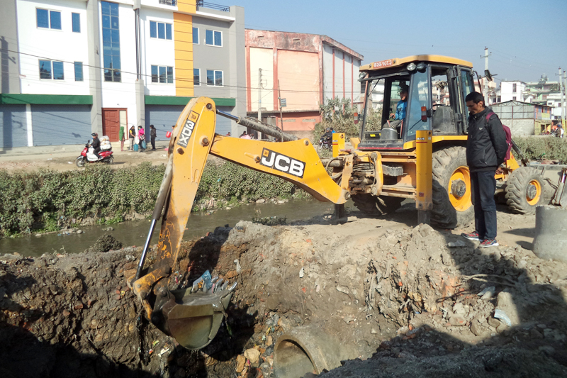 An excavator installs sewage pipe by the Rudramati River in Kathmandu, on Monday, February 13, 2017. Photo: RSS