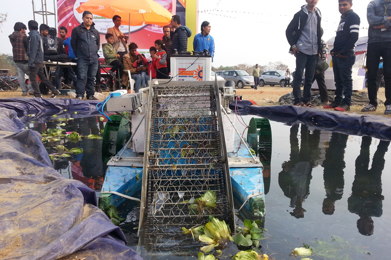 Visitors observe a technology to control hyacinth in ponds and lakes, exhibited at the CAN Info-Tech, in Pokhara of Kaski district, on Saturday, February 18, 2017. Photo: Rup Narayan Dhakal