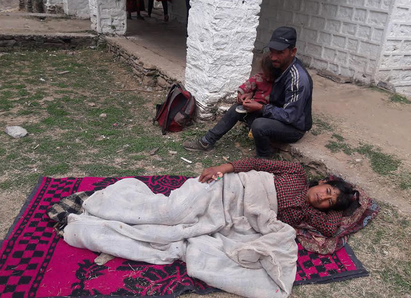 A woman resting after surgery for uterine prolapse in a free health camp jointly organised by the DHO and nNepalgunj Medical College at Bajura DHO, on Tuesday, February 21, 2017. Photo: THT