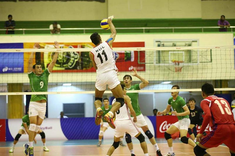 Nepalu2019s Kul Bahadur Thapa jumps for a spike against Turkmenistan during their third AVC Central Zone Volleyball Tournament match in Maldives on Thursday, March 23, 2017. Photo courtesy: PSM Sports