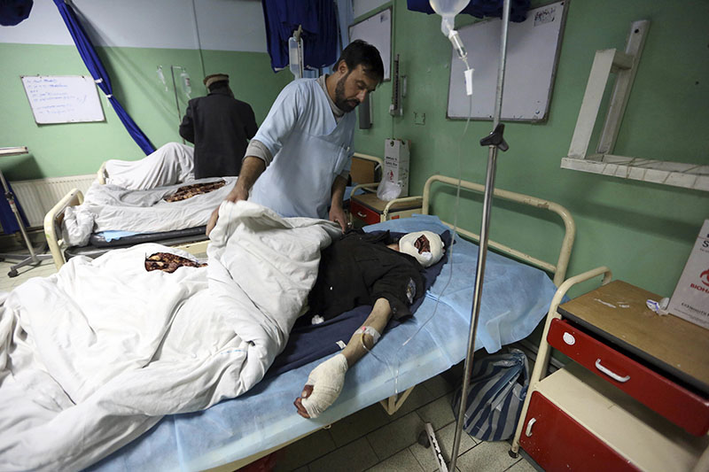 Injured men recover at a hospital after a suicide attack in Kabul, Afghanistan, on Wednesday, March 1, 2017. A pair of suicide bombings, both claimed by the Taliban, struck the Afghan capital, an Afghan official said. Photo: AP