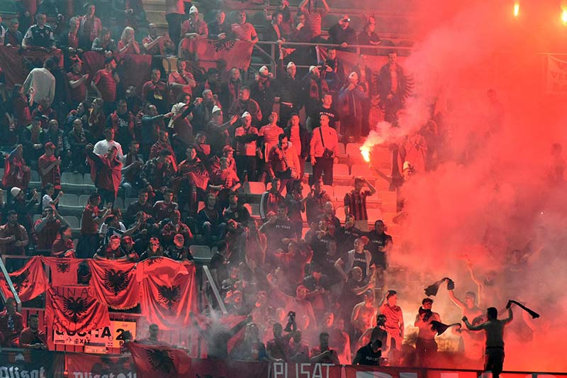 Albania's supporters light flares during a 2018 World Cup Group G qualifying soccer match between Italy and Albania, at the Renzo Barbera stadium, in Palermo, Italy, on Friday, March 24, 2017. Photo: AP