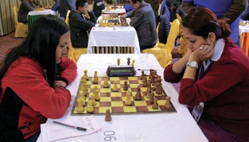 Nepalu2019s Shanta Thapa and Sabina Shrestha ponder their moves during the second round match of the Asian Zonal 3.2 Chess Championship in Kathmandu on Monday, March 20, 2017. Photo: THT