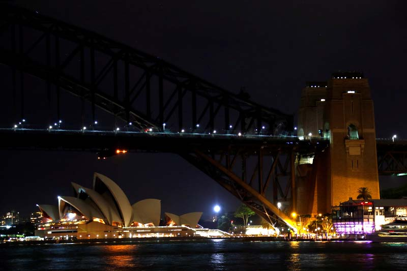 The Sydney Harbour Bridge and Opera House seen during the tenth anniversary of Earth Hour in Sydney, Australia, on Saturday, March 25, 2017. Photo: Reuters