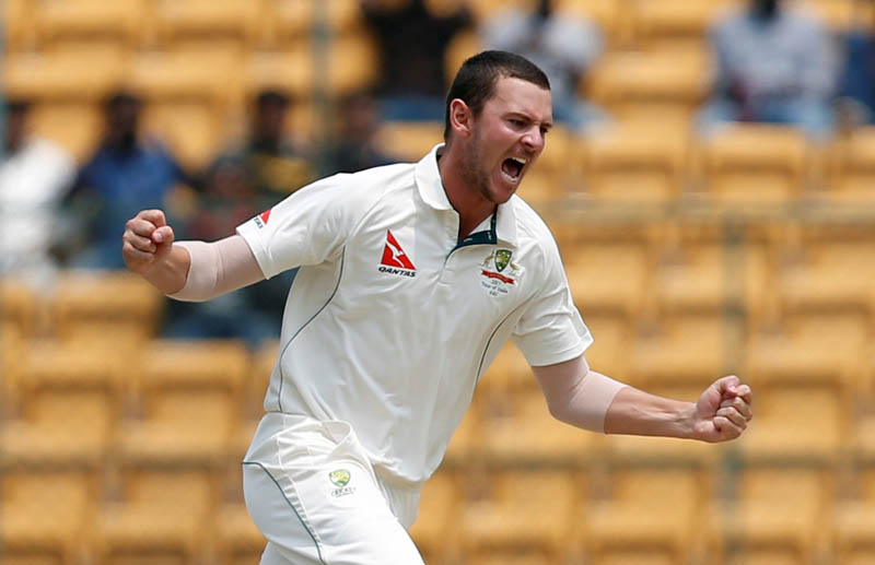 Australia's Josh Hazlewood celebrates the wicket of India's Abhinav Mukund. Photo: Reuters