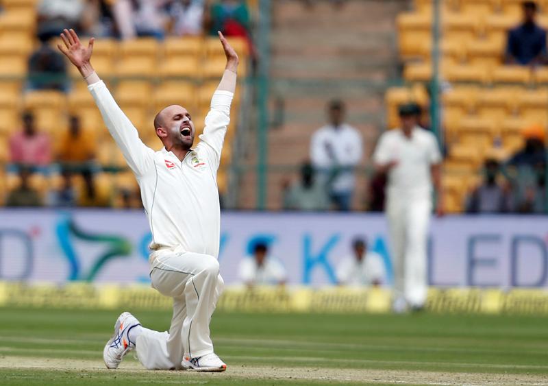 Australia's Nathan Lyon celebrates the wicket of India's captain Virat Kohli. Photo: Reuters