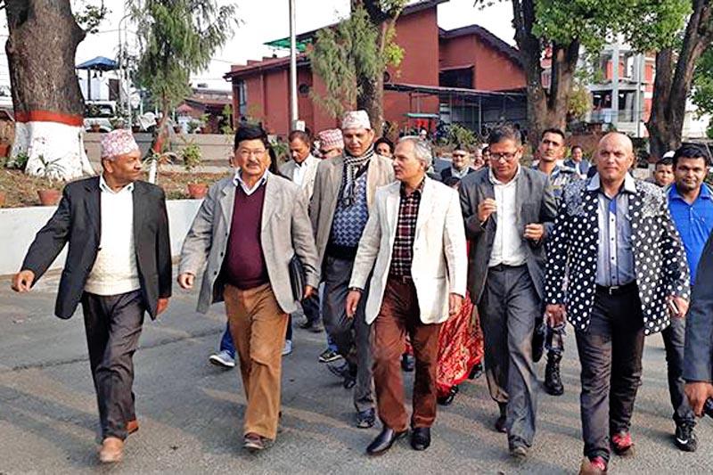 Naya Shakti Party Nepal coordinator Baburam Bhattarai along with other leaders walks towards the PM's residence to submit a memorandum to the Prime Minister Pushpa Kamal Dahal, in Baluwatar, Kathmandu, on Thursday, March 30, 2017. Courtesy: NSPN/Twitter