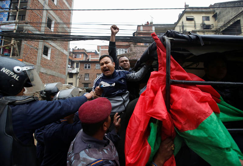 Nepal Police personnel detain activists affiliated with Madhesi Front during their general strike condemning the killing of protesters in Rajbiraj, in Lalitpur, Nepal March 10, 2017. Photo: Reuters