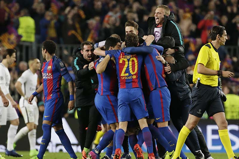 Barcelona players celebrate at the end of the Champions League round of 16, second leg soccer match between FC Barcelona and Paris Saint Germain at the Camp Nou stadium in Barcelona, Spain, on Wednesday March 8, 2017. Barcelona won 6-1. Photo: AP