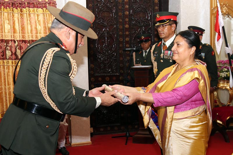 Nepal's President Bidya Devi Bhandari confers the honorary rank of General of the Nepal Army on the Chief of Army staff of India, Bipin Rawat, amid a special function at the Sheetal Niwas in Kathmandu, on Wednesday, March 29, 2017. Photo: RSS