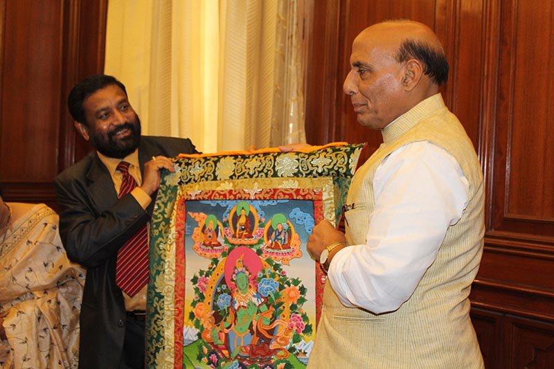 Deputy Prime Minister and Minister for Home Affairs Bimalendra Nidhi presents an honorary gift of thangka to his Indian counterpart Rajnath Singh (right), in New Delhi, India, on Thursday, March 16, 2017. Minister Nidhi is on state visit to India in New Delhi to attend a counter-terrorism conference scheduled from March 14 to 16. Photo: Ramjee Dahal