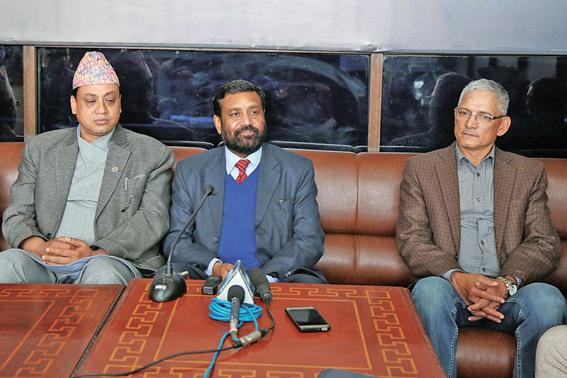 Deputy Prime Minister and Home Minister Bimalendra Nidhi (centre) talking to mediapersons at Tribhuvan International Airport, in Kathmandu, on Monday, March 13, 2017. Photo: RSS